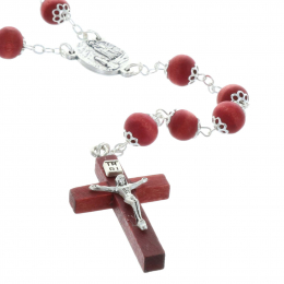 Rose-scented rosary and Lourdes Apparition in a box