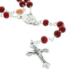 Rose-scented rosary in a glass bottle