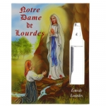 Lourdes prayer card and a vial of Lourdes water