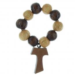 One decade rosary with wood grain and a Tau cross