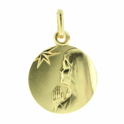 Gold plated medal of a Madonna with stars